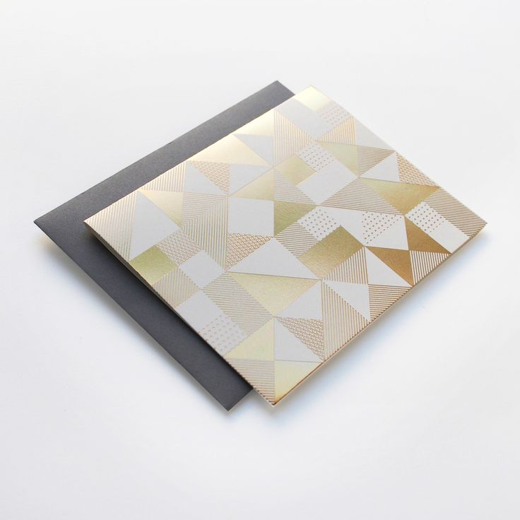 "Our Geometric Pattern card is letterpress printed with high quality gold foil on a thick natural white card._Paired with a grey envelope_Folded card, blank inside_1 card   1 envelope_Size: 5.5"" by 4.25 inches"