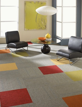 A Few Pops Of Colorful Carpet Tile Really Stand Out Against A Grey Carpet.