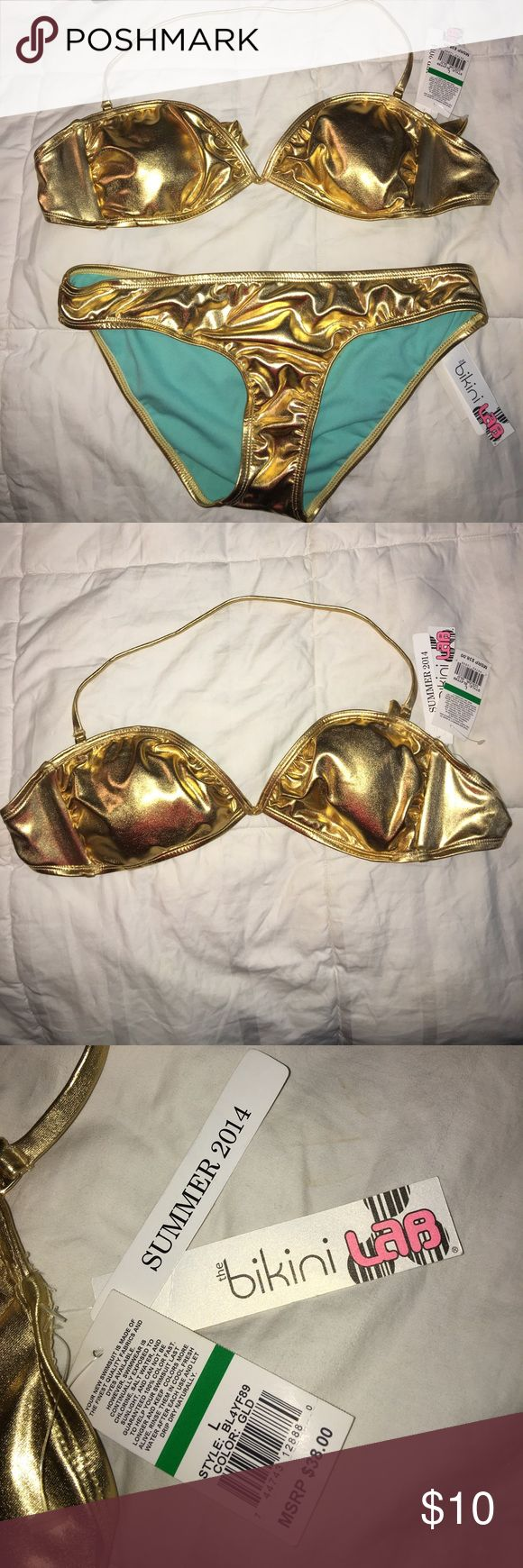 Brand new Gold bikini top and bottom set! Brand new with tags still attached. Never been worn gold bikini. Top is a halter string tie. Purchase includes both top and bottom! Swim Bikinis