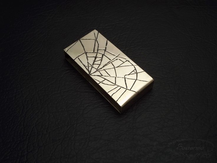 Rectangular brass spacer with engraved spider's web motif