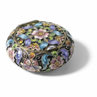 A FABERGÉ SILVER-GILT AND CLOISONNÉ ENAMEL PILL BOX, WORKMASTER FEODOR RÜCKERT, MOSCOW, 1908-1917 of circular cushion form, the surface painted with shaded polychrome enamel flowers on a stippled ground, 88 standard.