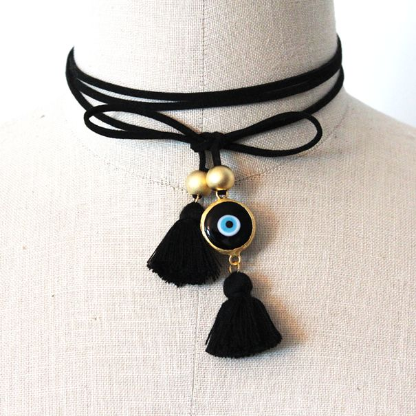 "A part of our latest collection this ""Black Suede Eye Chocker"" is a trendy piece that can be worn many different ways. It can be a chocker, a necklace or even a bracelet. One size fits all with a simple tie or bow. It is made of black suede ribbon, 24K gold plated eye and round beads and black cotton tassel. Shop this piece and more online at http://www.alangoo.com/spenta-armaiti"
