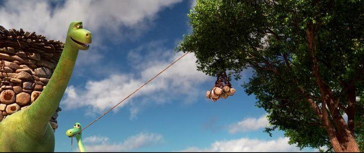 Poppa (Jeffrey Wright) teaches Arlo (Raymond Ochoa) how to trap a critter in THE GOOD DINOSAUR. Courtesy of Disney-Pixar.