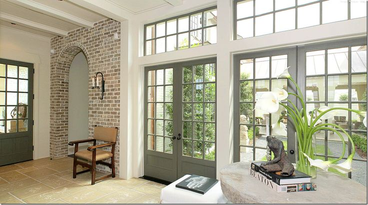 love these grey french doors, tall transoms and brick with lots of lime and wide white grout lines.