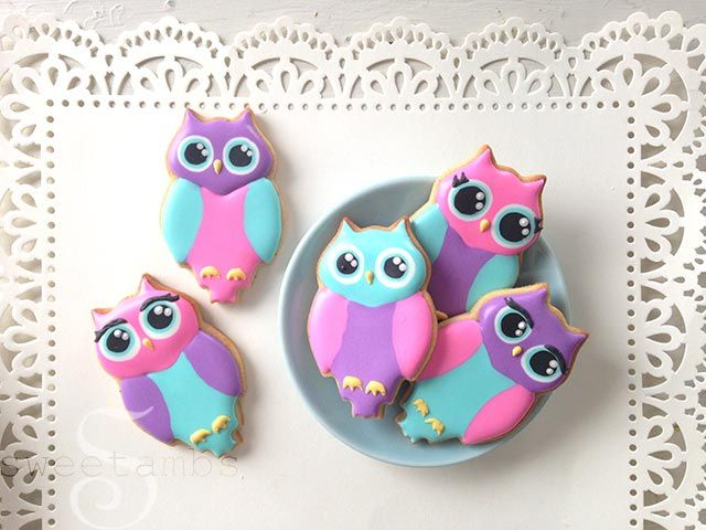 Owl-Cookies2: Roll out cookie dough. Owl cookie cutter (you'll see in the video that I altered mine a bit!) Flood consistency royal icing in pink, purple, blue, yellow and black Decorating tips 1 and 2 Scribe tool Colors: Pink = Wilton Rose Blue = Wilton Teal Purple = Wilton Rose + SkyBlue (you could also use Wilton Violet, I just didn't have any on hand) Yellow = Wilton Buttercup Yellow from the Garden Tone Set Black = Americolor Super Black