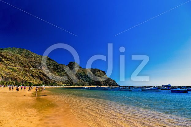 Qdiz Stock Photos | Beach Las Teresitas with water and waves on yellow sand,  #aerial #Atlantic #background #beach #blue #boat #Canary #coast #coastline #Cruz #island #landscape #LasTeresitas #mountain #nature #ocean #people #playa #rock #sand #Santa #sea #ship #shore #sky #Spain #spring #summer #Tenerife #view #water #wave #yellow