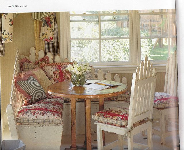 WOW! Take a look at this kitchen bench seat - it's backed with a corner section of an old picket fence = so sweet!