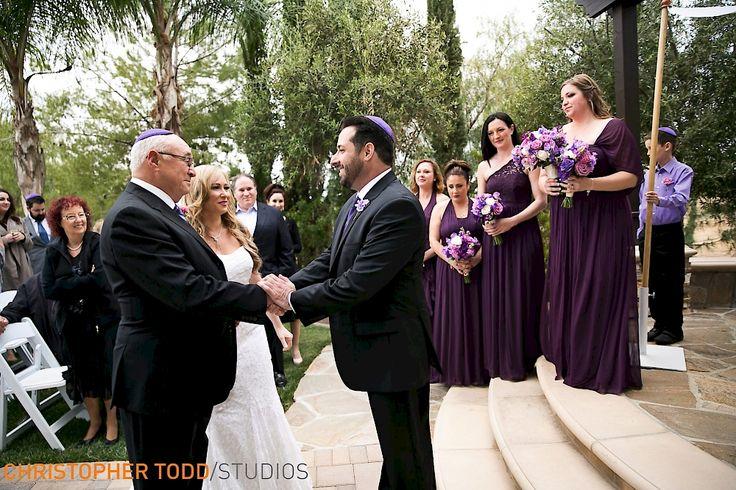 father presents bride to groom at ceremony danza del sol temecula winery wedding