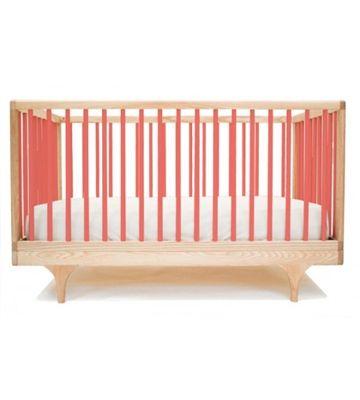 Kalon Studio's custom Caravan Crib comes in many colors....  http://www.modernkidsdesign.com/Kalon-Caravan-Crib-p/41.htm