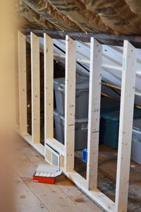 storage behind knee wall. Insulation should be pinned against the wall and supported. It's not now