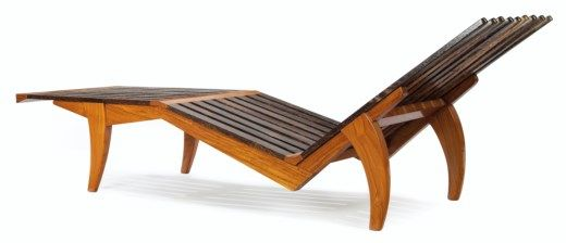 A SOUTHEAST ASIAN PALM WOOD CHAISE LOUNGE MODERN