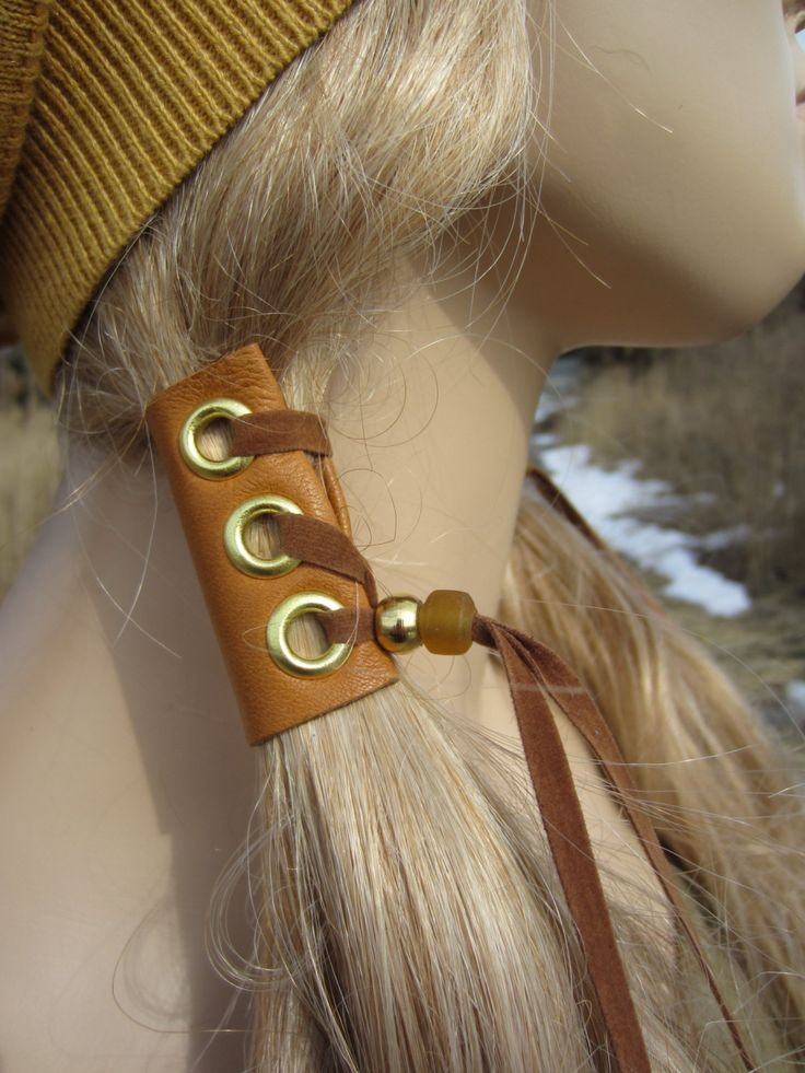 2 Leather Hair Wrap Extensions Ponytail Holder Hair Jewelry Native American Bohemian Style. $38.00, via Etsy.