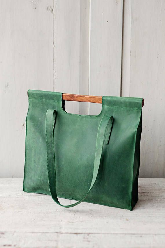 This medium size leather tote bag is original style shopping bag as it has wooden handles. It is our new model. This tote bag brought its name together with a smoke of good cigar, smell of real black coffee and sounds of salsa drums. We called it Havana.  The bag is medium size, but it is