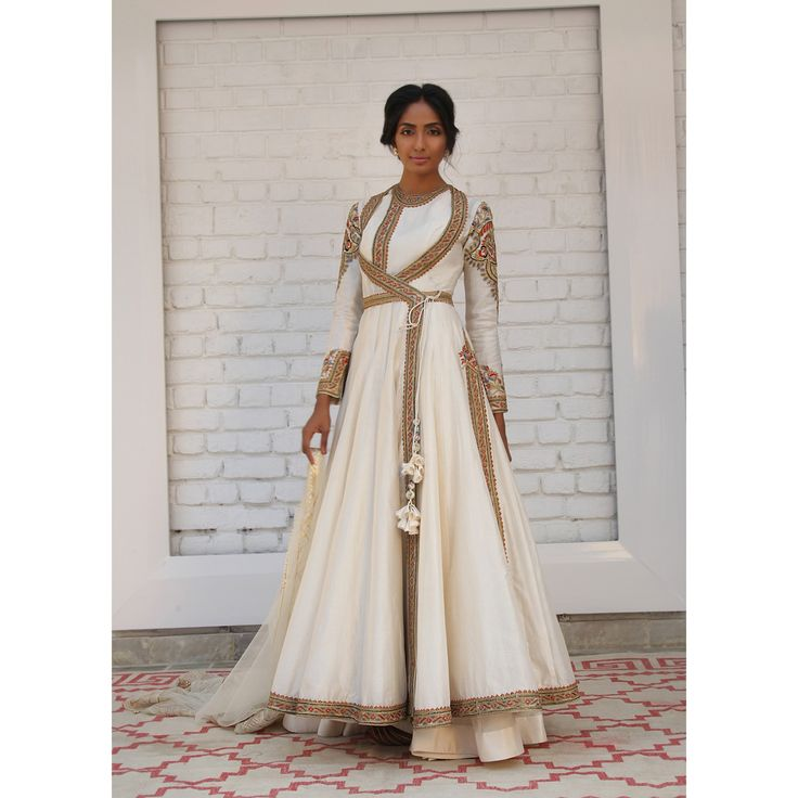 simple Ivory white Chanderi silk layered angrakha with side tie up featuring with delicate resham-tilla embroidery; paired with a soft tulle dupatta and sharara by Rimple & Harpreet Narula