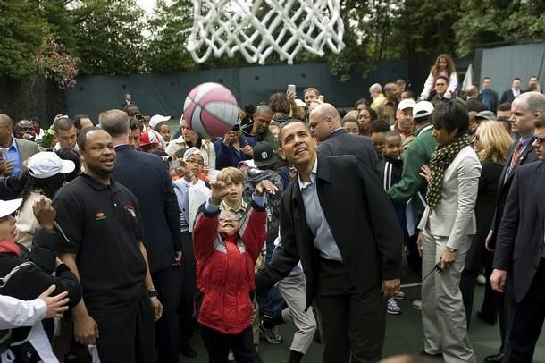 President Barack Obama watches as a child shoots a basket during the 2009 White House Easter Egg Roll on the South Lawn in Washington, DC, April 13, 2009.