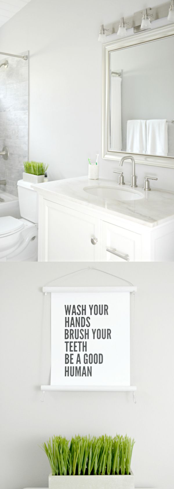 Easy guest and kids shared bathroom update on a budget! See how she swapped and added hardware, used budget friendly lighting and finished it off with a kid friendly printable. AD Bathroom update on a budget - easy budget friendly bathroom updates from Lowe's - Grey and white modern bathroom from Hello Splendid