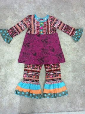 Fabulous, Fun, and Funky come to mind when I look at this outfit!  The seasonal soft floral fabric paired with a deep purple embroidered body completes the tunic.  The Leggings are made from the same soft material as the tunic and features a three tiered ruffle of blue, orange, and polk-a-dots around the hem.   This outfit is perfect for the entire fall and winter season.  It could be worn for pictures, family dinners, Thanksgiving, or everyday.