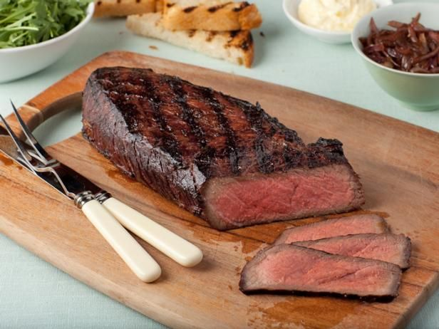 Serve this juicy whole London Broil with Onion Marmalade with grilled bread and arugula. It's the perfect centerpiece for an outdoor lunch or a casual dinner buffet.