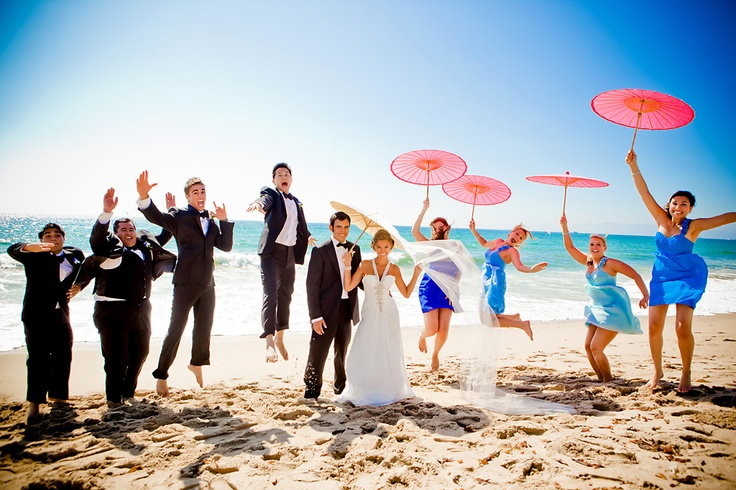 They brought their own parasols and the bride attached a veil to hers..so cute!