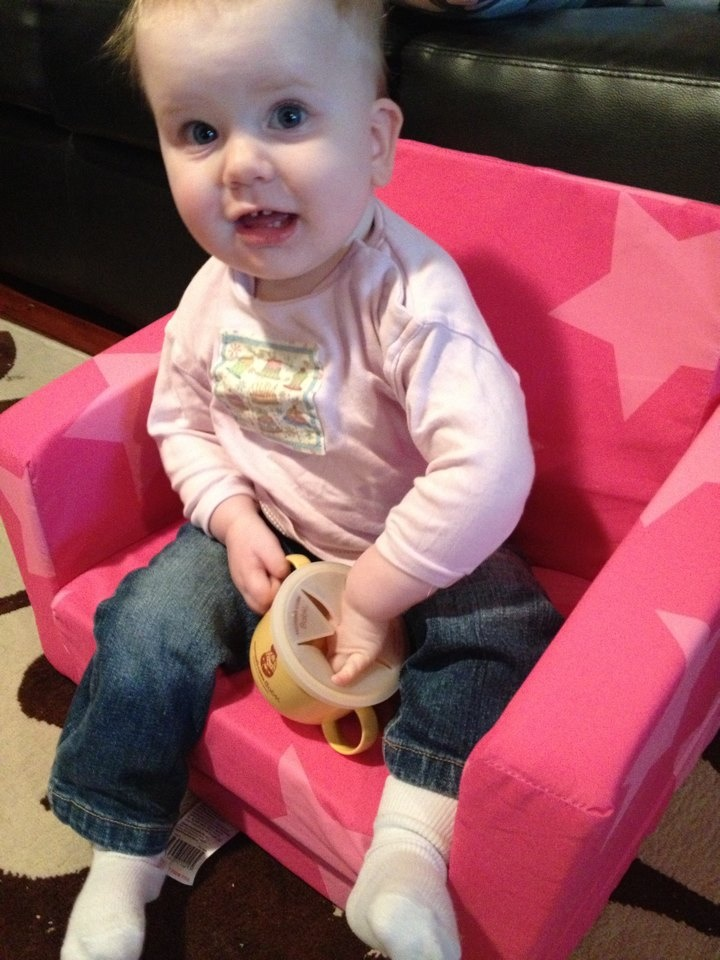 Charlotte(16months old) looks very comfortable feeding herself from the snack cup!