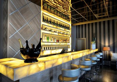 Lit onyx at L'Arc Paris Restaurant and Club by Prospect Design.