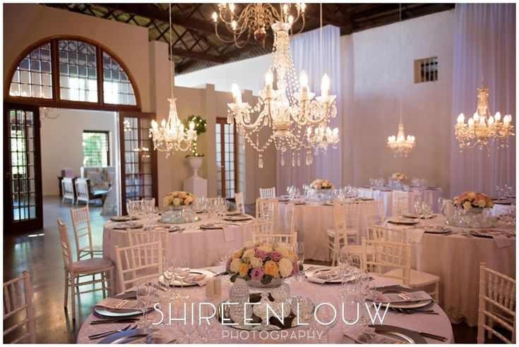 Chandeliers at wedding reception create ambiance
