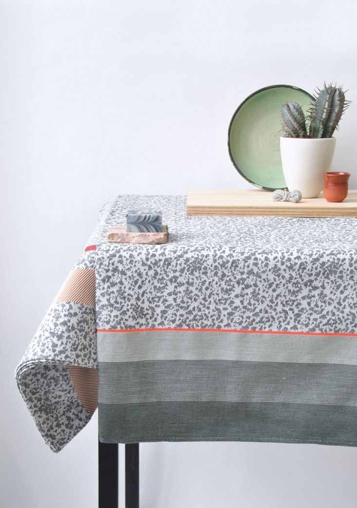 Flock table cloth inspired by marble with a delicate orange stripe by artist Mae Engelgeer