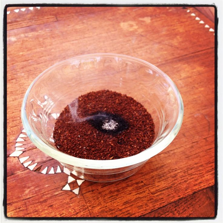 Fill an ashtray with coffee grounds and light to keep flies away.  A tip from a friend and it really works..