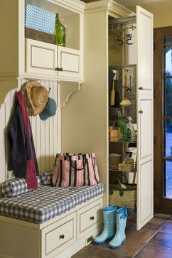 Love love love this idea for a mudroom! They used similar sliding cabinets as can be found in a kitchen - great resource!