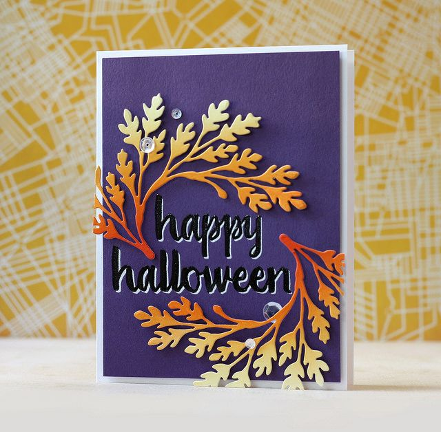 Used a sentiment from the Halloween Trimmings Stamp & Cut set. I embossed the sentiment in white and then embossed it again in black but a little bit offset. Love how this looks on the dark purple cardstock. I blended Candied Apple, Carved Pumpkin & Squeezed Lemonade on some cardstock and then die cut it using one the the branch dies from the Main Hero Arts Kit.