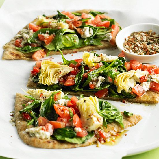 Ingredients: whole wheat flat bread, 3tablespoonsolive oil 6cupsfresh spinach leaves 6ounces, artichokes, tomatoes, etc. Be sure to omit non-Daniel-Fast-options like goat cheese.
