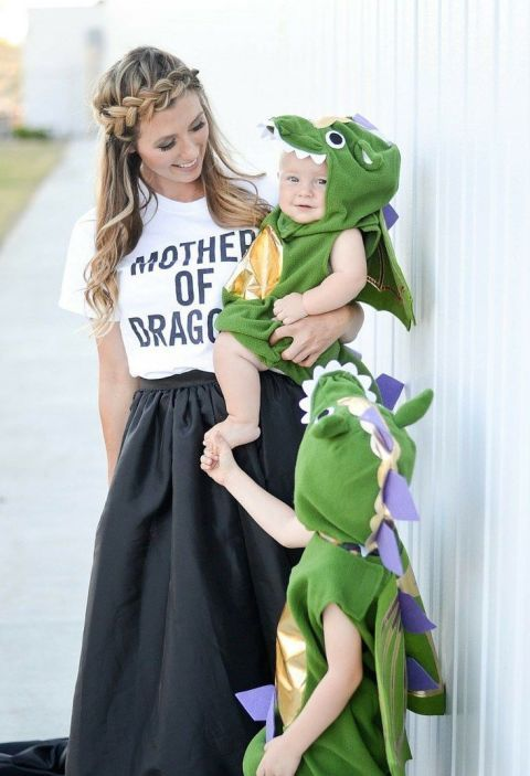 """19 DIY Kids' Halloween Costumes That Are So Cute You'll Want to Cry: MOTHER OF DRAGONS. Family costumes are guaranteed to get oohs and aahs when you head out to trick-or-treat (not to mention, they really simplify the costume choosing process). And this one, by Bel & Beau, is the perfect combo of adult humor and kid fun. You get to live out your Game of Thrones fantasy as a pun-ny """"mother of dragons"""" and your little ones get to be, well, dragons. See more at Baby Bird's Farm and Cocina."""