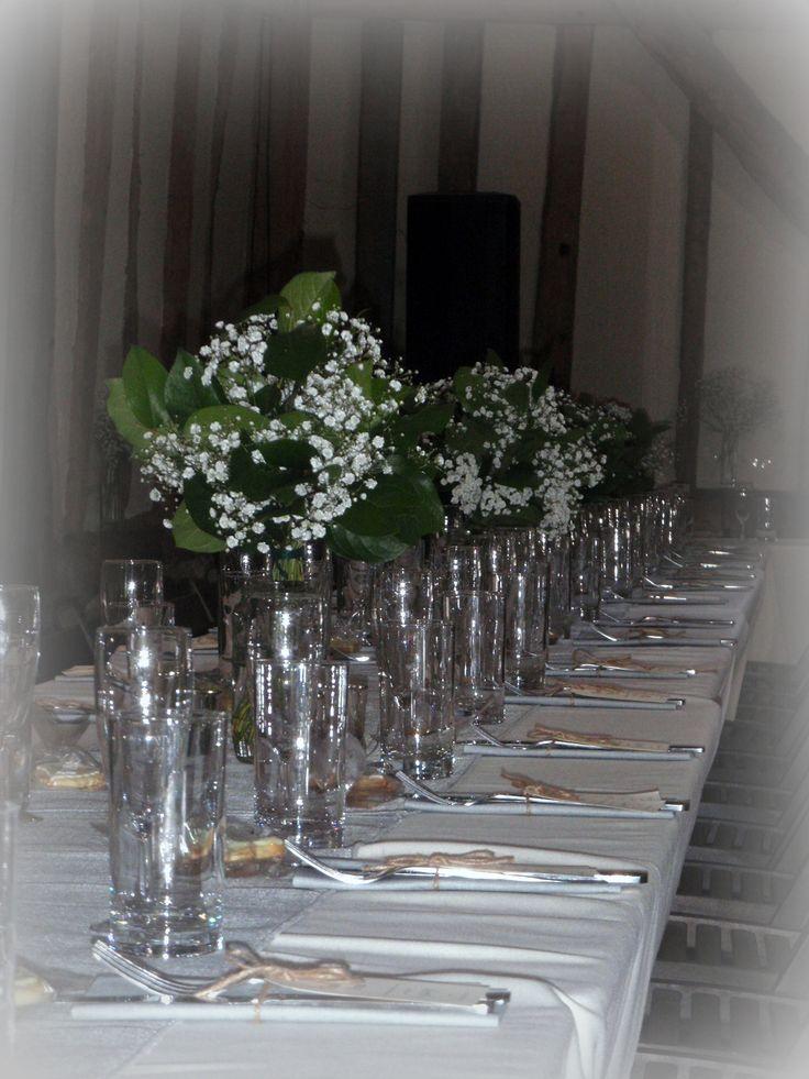 woodland theme table decorations using gypsophila and foliage