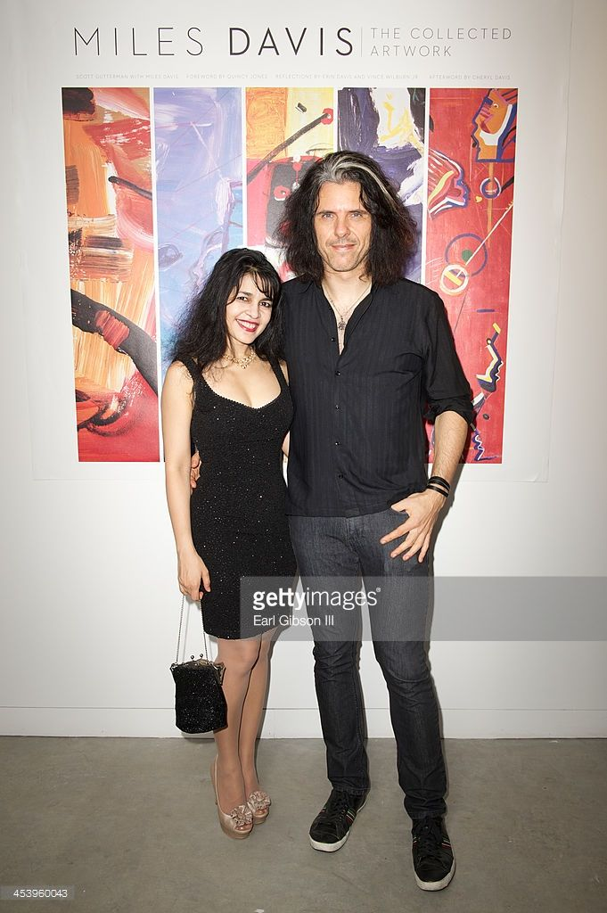 Maddy Samaddar Johnson and Alex Skolnick attend the 'Miles Davis: The Collected Artwork' Holiday Pop-Up Gallery at Gallery 151 on December 5, 2013 in New York City.