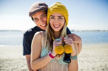 Young hipster couple at the beach.