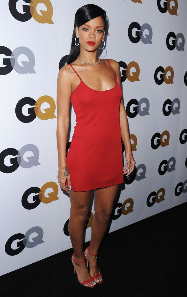 Rihanna looks stunning in a simple red Calvin Klein dress at the GQ Men of the Year awards in Los Angeles. It's the red version of the one Cher wears in Clueless!