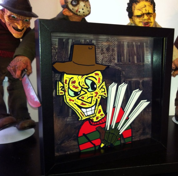 This Freddy Krueger A Nightmare on Elm Street Art will make you not want to fall asleep. Freddy Krueger is hand made with paper cut pop art effects. The artwork features 2D and 3D elements. Freddy's entire body is rendered in 2D, while his face, hat and glove are in 3D. This is the perfect gift for any horror fan! The artwork comes framed in a black shadow box frame and is hand signed by the artist. Dimensions: 10x10″ Framed