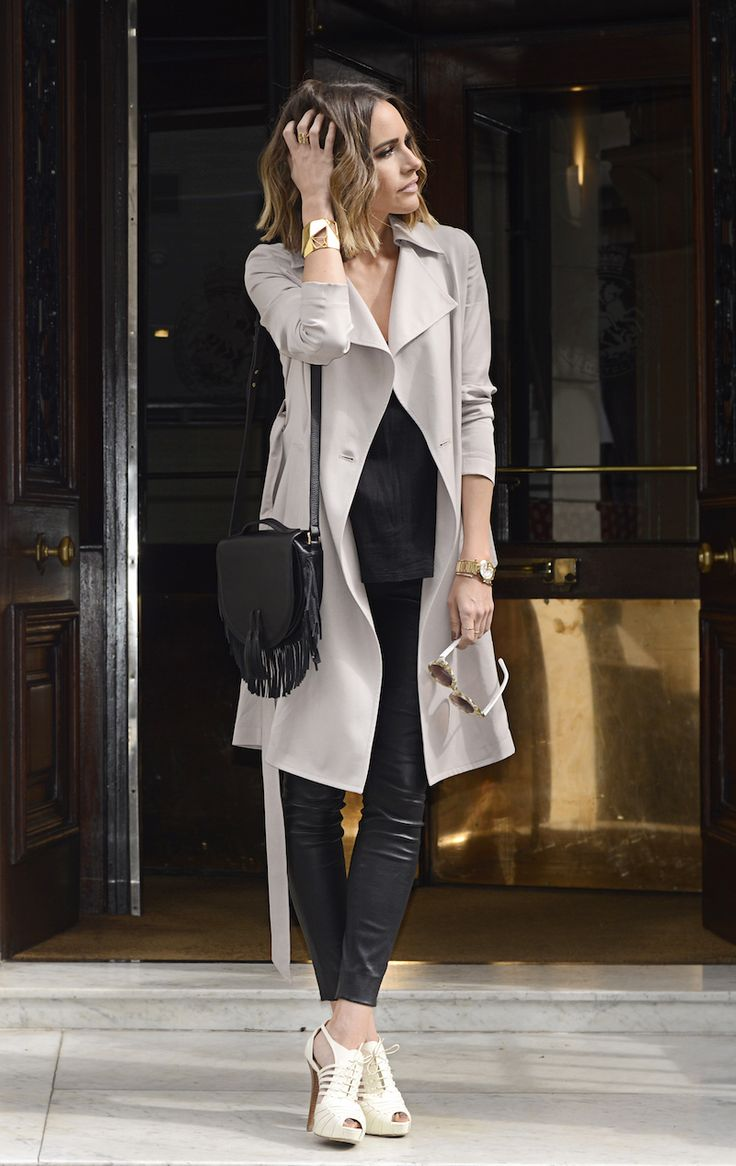 Louise Roe looks a vision in monochrome, pairing gorgeous white stilettos with leather leggings and a statement off-white trench. This look is the way to go if you want street glam! Trench: Reiss, Trousers/Shoes: Ralph Lauren, Bag: Meli Melo.