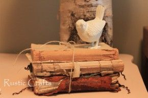 I love how these old shabby books are simply tied together and put out on display. (The little bird's a cute touch!)