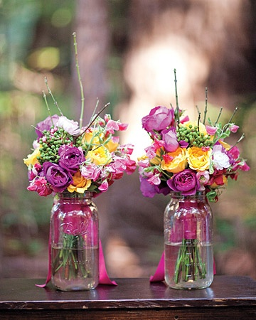 using bridesmaid's bouquets as decor at reception (and loving the mason jars!)