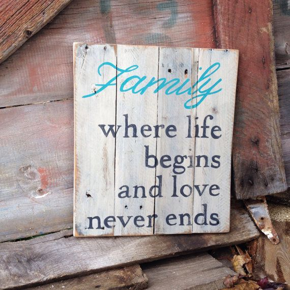 Family: where life begins and love never ends Cottage Chic white sign made out of recycled and repurposed pallet wood. This rustic wood wall