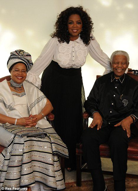 In celebration: Oprah with Nelson Mandela and wife Graca Michel at the ...