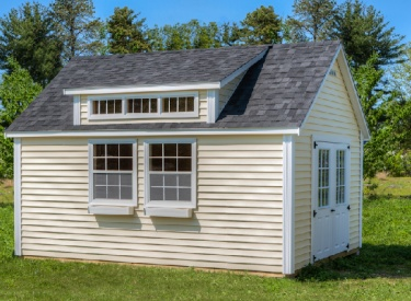Post Woodworking: Lexington Style Shed. This shed has an added Shed Dormer with transom window. Vintage Cream Vinyl Siding with a Dual Black Roof. Click the image to visit online or call 1.866.PWI.SHED