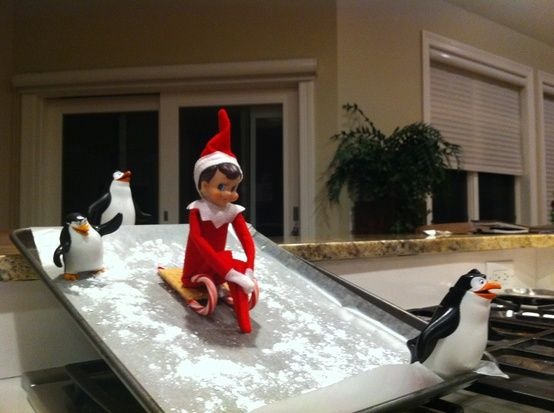 Sledding down a cookie sheet dusted with powdered sugar