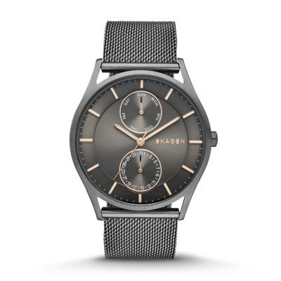 Tailored in detail, timeless in design: the Holst works for men and women alike. Recessed into the brushed steel 40-mm case is a clean matte-finish dial with fine strokes marking off hours and minutes. Two inner subdials display day and date. A thick mesh band with fold-over clasp conforms perfectly to the wrist.