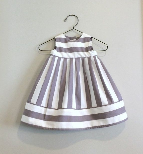 Choose size 0-3, 3-6, or 6-12 months old, made of 100% cotton fabric. Fabric has 1 light gray and cream stripes. Includes 2 snap closures on the
