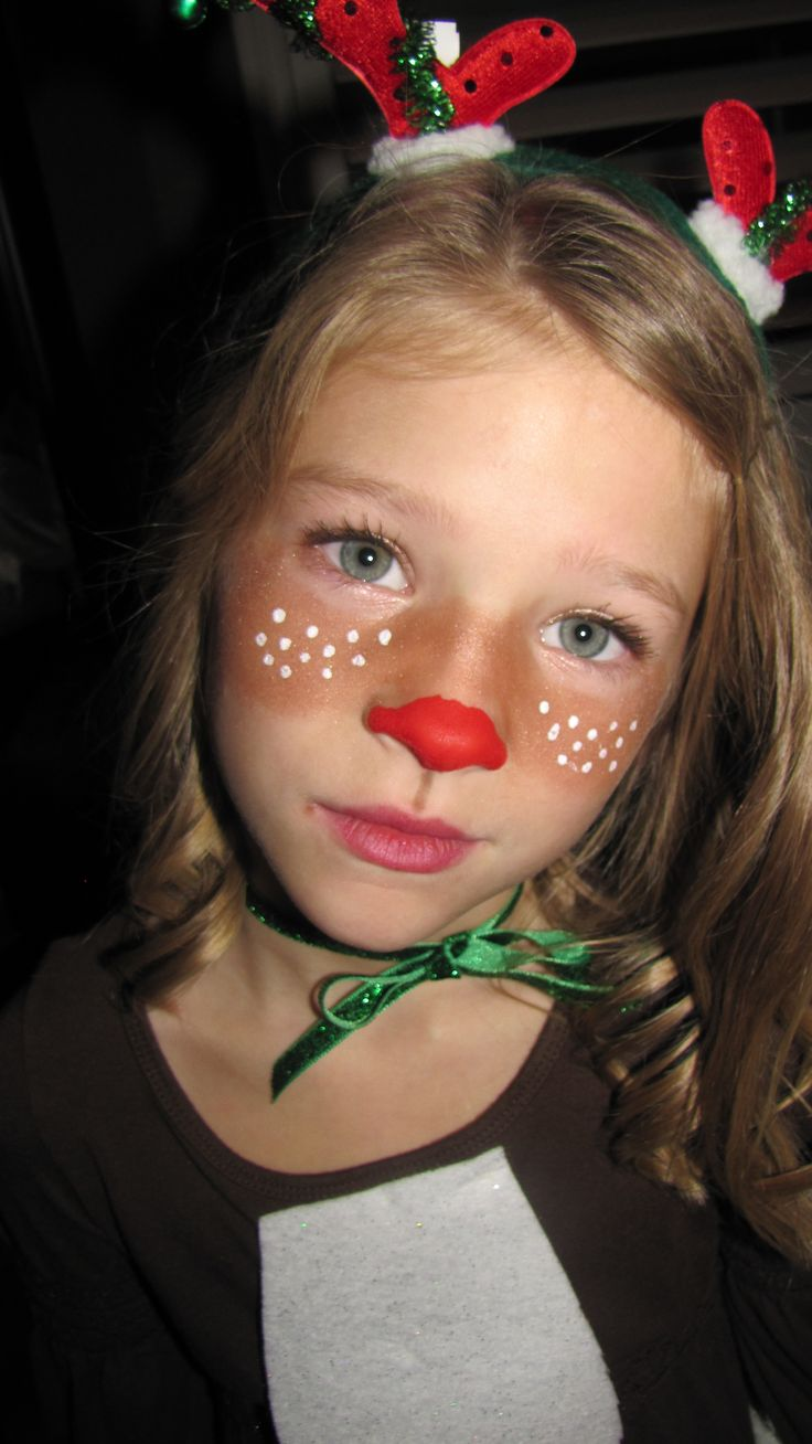 Quick Rudolph, face bronzer for brown cheeks and acrylic paint for nose and white dots, who needs face paint!  Stick on an antler head band and your are set.