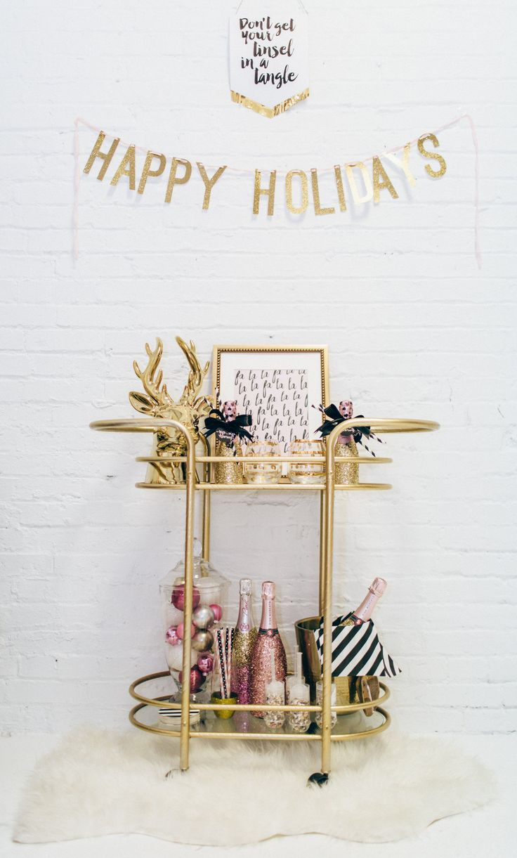 Pretty Christmas Holiday Bar Cart decorations. Happy Holidays. Fa la la la - Free Printable - DGD Invitations