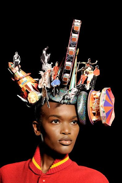 It's a circus on your head! A model showcases designs on the catwalk by Philip Treacy