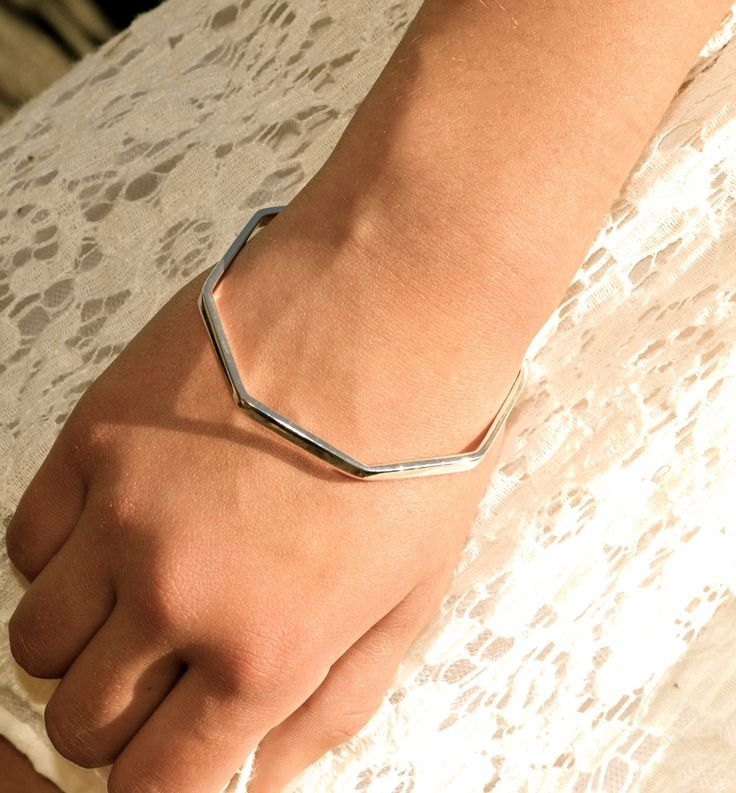 This solid sterling silver Octagon bangle is contemporary & fun.